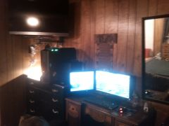 A closeup of the TV on the wallmount haphazardly setup along with my gaming center (the dual monitors + seating area).